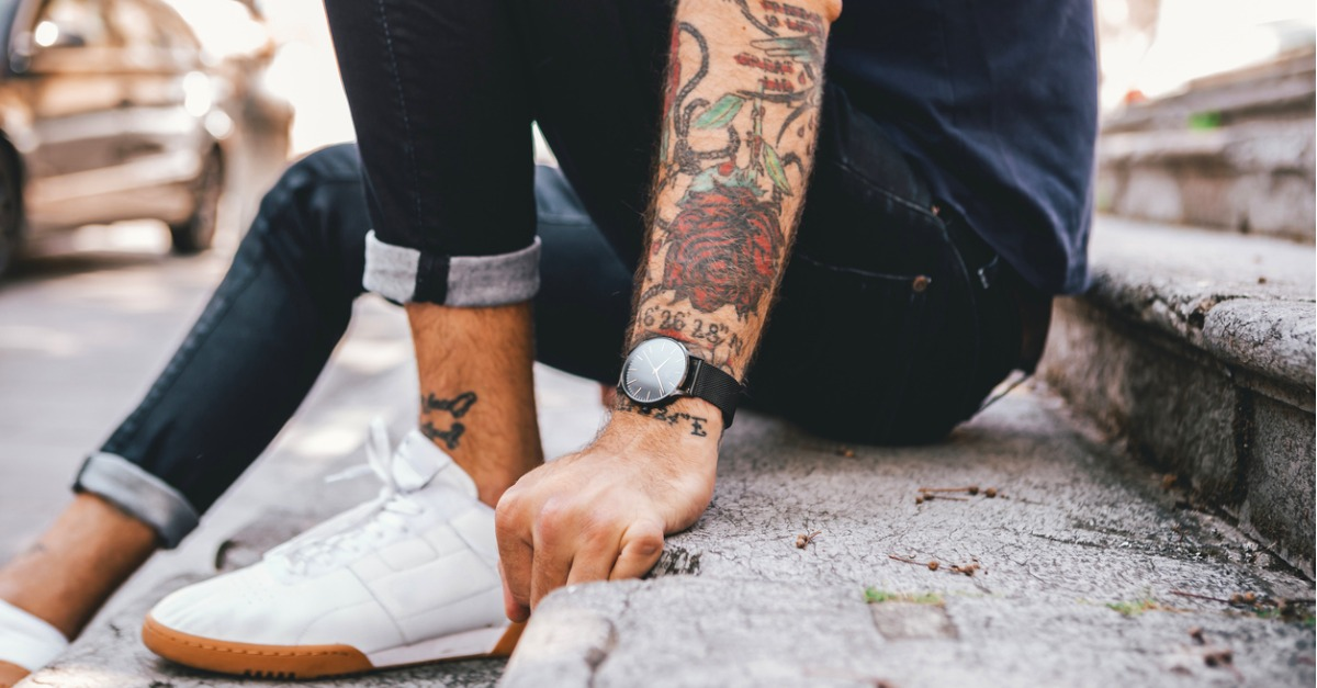 Young man with colorful tattoo sleeve.