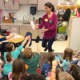 Paula Garcia Todd showing a cloud in a bottle to a group of students.