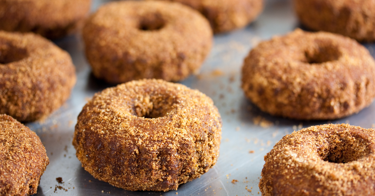 Tray of freshly made vegan apple cider doughnuts